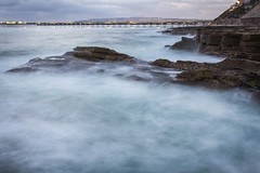 Ocean Beach: Cliffs and Pier (Photos By Clark) Tags: beachshots california canon2470 canon60d cities locale location northamerica places sandiego subjects unitedstates where pacific waves pier ob water rocks cliffs longexpo longexposure lights lightroom