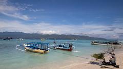 The Eastern Side of Gili Trawangan (HansPermana) Tags: lombok indonesia gilitrawangan holiday trip travel relax happy island bluesky sea blue water boats mountain seascape seashore clear