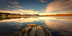 Lake Alexandrina as golden hour sets in (Yani Dubin) Tags: water landscape multipleexposures d7000 tokinaaf1228mmf4 widelens southisland waterscape bright lakealexandrina darktable reflections newzealand spring nature canterbury exposureblending serenity mackenziedistrict lake tranquility gimp