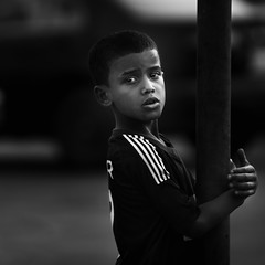 Holding the pole (Zuhair Ahmad) Tags: canon 400d 70200mm portrait bw black white dar tone street boy kid dammam saudi arabia copyrights zuhair ahmad 2012