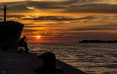 fisherman in sunset (tomi1302 www.tomiburcul.com) Tags: canon 650d 50mm sunset ship sea sky croatia zadar landscape clouds