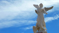 Angel Unchained (Eye of Brice Retailleau) Tags: icon effigy figure statue beauty colourful colours composition scenery scenic urban street streetphotography sculpture extrieur closeup angel clouds cloudscape sky bluesky mexico mexique zacatecas