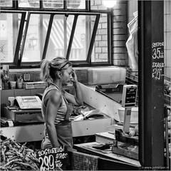 Where do I begin... (John Riper) Tags: johnriper street photography straatfotografie square vierkant bw black white zwartwit mono monochrome hungary budapest candid john riper fujifilm fuji xt1 18135 woman green grocer stall market hall