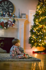 Learning about ol' Saint Nick (n.shipp12) Tags: columbus ohio photographer christmas imagination believe pajamas little toddler christmastree moment child naturallight canon 50mm f14 photography