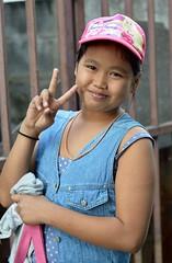 a preteen girl sends you peace (the foreign photographer - ) Tags: cute girl sign portraits thailand peace bangkok preteen overweight khlong bangkhen thanon
