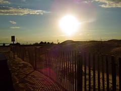 Sunset (jessicabragen) Tags: ocean sunset sky seagulls lighthouse beach clouds newjersey waves gulls shore jersey sandyhook jerseystrong
