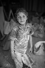 The work of a Syrian child (Giulio Magnifico) Tags: life lighting urban smile composition contrast children intense eyes war alone loneliness shadows child power emotion expression live refugee refugees muslim streetphotography streetportrait sharp essence gaze glance turchia kilis nikond800e sigma35mmf14dghsm