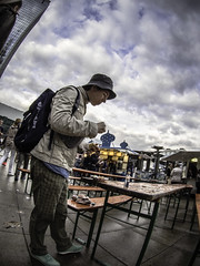Woman eating at folding Table (kohlmann.sascha) Tags: street sky people food woman cloud berlin hat dinner bench lens table landscape lunch photography donna clothing essen fotografie dress place furniture eating femme mulher streetphotography streetportrait himmel wolke wolken technik olympus menschen fisheye clothes eat hut cap alexanderplatz möbel dine frau tisch technique landschaft groceries mitte mütze ort mensch kleidung headgear thema berlinmitte nahrung lebensmittel mahlzeit 女人 objektiv bekleidung 女子 kopfbedeckung handlung streetfotografie laseñora strasenfotografie же́нщина фра́у strasenfotografiemitfisheye streetwithfisheye v325040bw000 bodycap9mm1 olympusbodycap9mm1
