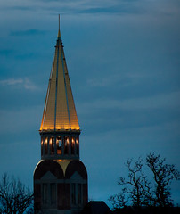 Night Light (docoverachiever) Tags: blue light building tower silhouette night clouds gold colorado denver universityofdenver copperroof flickrchallengegroup