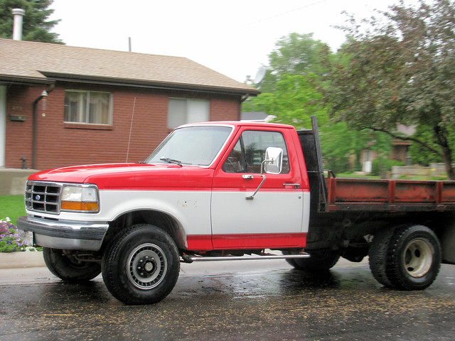 red white classic ford truck vintage 4x4 pickup pickuptruck vehicle 1990s madeinusa americanmade flatbed fourwheeldrive f350 heavyduty fomoco twotone 1ton dually worktruck farmtruck fseries eyellgeteven