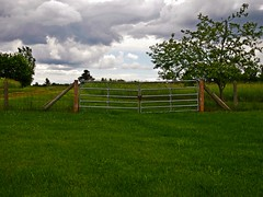 HFF-old and new with stormy sky (Explore!) (SCOTTS WORLD) Tags: park trees light summer sky green nature grass leaves clouds rural fence landscape fun midwest gate pov michigan country july stormy adventure orion 248 2014 hff oaklandcounty olympusepm1