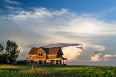 Warped House (TigerPal) Tags: saskatchewan sask rural rurex plains prairie backroads exploration sky skies cloud clouds dustyroad gravelroad lakediefenbaker summer eskbank warpedhouse oncewashome