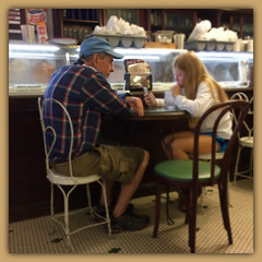 THE GENERATION GAP (NC Cigany) Tags: nc pittsboro woman chairs granddaughter grandfather icecream iphone6 man restaurant thesodashoppe food generationgap