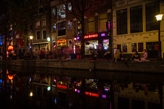Red Light District (Ash and Debris) Tags: night netherlands street water redlights city evening nightlife urbanlife streetlife canal urban old dark reflection lights architecture reflections holland europe amsterdam light motion red district