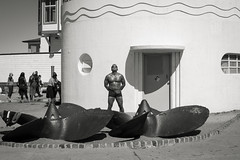 my attempt to emulate him was thwarted by my ego (Super G) Tags: nikon287 sanfrancisco california candid streetphotography bw blackandwhite man standing swimsuit ofsorts bodybuilder propeller tanning stoic statuesque bronze deco