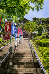 Stairway To The Temple (Pikaglace) Tags: sony a7 kamakura engageji japan japon stairs escaliers statues drapeau religion religious blue red vertical