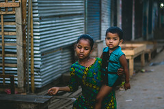 Siblings (Ajwad Mohimin) Tags: bangladeshi bangladesh siblings 50mm canon canonphotos canon60d color light natural lightroom green blue boy girl child brother sister neighbour cute