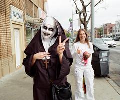 A Thumb's Up for Peace (Georgie_grrl) Tags: filmphotographyscavengerhunt bydowntowncamera october2016 challenges idea fun competition pentaxk1000 rikenon12828mm toronto ontario zombies nun alien et zombiewalk stclairavenuewest