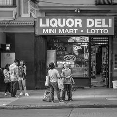 shakedown at the mini mart (Super G) Tags: nikon290 streetphotography candid people boy woman girl liquor deli lotto open standing bw blackandwhite sanfrancisco