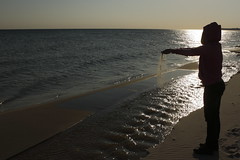 Time is like sands, slipping through our hands into a sea of eternity (J. Roseen) Tags: sea hav sunlight solljus siluette silhouette beach shore strand water vatten skne sterlen