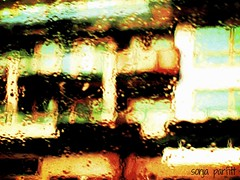 through the rain (Sonja Parfitt) Tags: bus window raining buildings manipulated