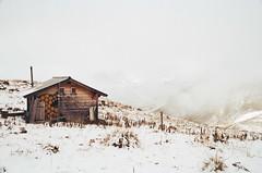 calm and quiet 2 (analog surfing) Tags: snow white clouds winter switzerland schweiz mountain analog hut cabin scan nikonfm2 kodak