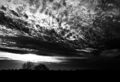 Sunset steels the sky (momrunninglate) Tags: sunset blackandwhite contrast clouds landscape sky kansas nature