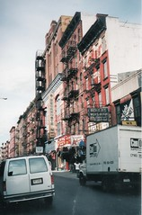 New York City NY ~ Orchard Street ~ Looking South from East Houston ~ Film 35mm 1990's (Onasill ~ Bill Badzo - 66M) Tags: street travel building sign shopping germany fire marketing discount neon little manhattan district side main houston landmark s orchard tourist historic wear east neighborhood e area mens jewish historical immigrants jews lower tenement attraction escapes enclave beckenstein adlers nrhp onasill yiiddish