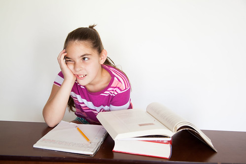 Distracted Child Studying by amenclinics_photos, on Flickr