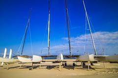 Catamarans (McQuaide Photography) Tags: longexposure sea holland beach netherlands strand canon eos coast boat seaside sand europe nederland wideangle zee catamaran nd dslr noordwijk zand kust uwa wideanglelens ndfilter ultrawideangle neutraldensityfilter neutraldensity noordwijkaanzee 100d ndx400 1018mm mcquaidephotography hoyandx400hmcfilter