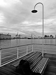 Genova (Carlo Mirante) Tags: city travel cruise shadow sea summer sky blackandwhite bw italy mer ferry port bench boat photo italia nuvole mare sailing ship loneliness estate liguria ombre genoa genova bow fujifilm moment fotografia bianco nero luce paesaggio lanterna citt gru assente panchina 2014 solitudine gnv portoantico landscapecity superba fujix20