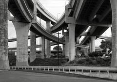 Freeway Tangle, Portland (austin granger) Tags: urban cars film portland concrete parking overpass tangle development largeformat freeways topography deardorff austingranger