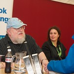 George R R Martin signs books for fans at the Edinburgh International Book Festival