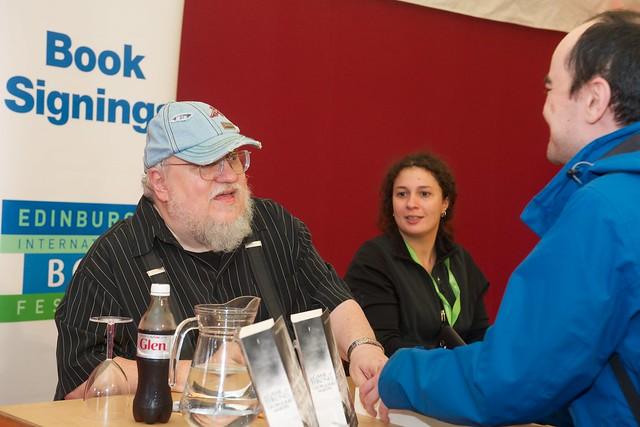 George R R Martin signs books for fans at the Edinburgh International Book Festival