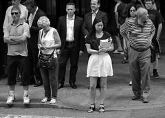 Why So Serious? (Anima Fotografie) Tags: street nyc summer urban blackandwhite bw usa newyork america us waiting serious manhattan streetphotography sidewalk metropolis 2014 steiner62 newyorkphotography canoneos7d