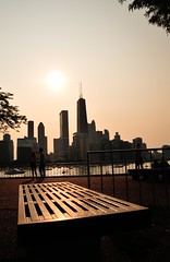 Seated at days end~HBM (mark-marshall) Tags: sunset chicago fence bench nikon lakemichigan d300 hbm 1855mmf3556 miltonleeolivepark