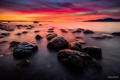 Sky on Fire (Alexis Birkill Photography) Tags: longexposure sunset seascape vancouver clouds landscape rocks ubc goldenhour acadiabeach