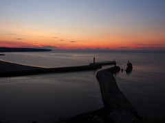 Whitby Pier's at dusk (cmax211) Tags: sunset sea sky cliff west dusk piers yorkshire east whitby infocus highquality