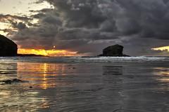 Portreath Sunset (Mr McCarthy!) Tags: sunset sea sky orange cliff cloud sun sunlight reflection beach sunshine clouds canon seaside sand cornwall cloudy gray sigma sunny cliffs hdr highdynamicrange cornish gullrock 550d