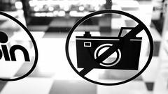 No? (Davide Laganà · Digital Artist) Tags: street camera white black window glass shop photography coin sticker negozio fujifilm fotografia ban vetrina bianco nero prohibition vetro divieto fotocamera adesivo fujinon23mmf2 x100s