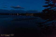 AFTER SUNSET (Wade.J.) Tags: sunset dusk twilight evening cloud cloudy blue sky clear mirror water pond lake smooth calm twinkle lights reflection tamron2875 rotary park gander newfoundland wadejanes