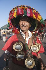 visit Marrakech (tours4morocco) Tags: watercarrier marrakech jamaaelfna square hat tassle entertainer morocco africa