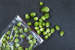 Brussels sprouts in a plastic bag (Olga_Z1982) Tags: brussel sprout organic vegetable bag green healthy vegetarian food heap cabbage crop gourmet salad group color refreshment groceries ingredient background nature large raw freshness plastic top view preform freezing