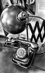 Telephone workplace (ANBerlin) Tags: numbers ziffern zahle dial whlscheibe reflektion reflection reflexion schatten shadow innen inside tisch table arbeitsplatz workplace stellwerk signalroom switchboard betriebswerk operation lampe lamp phone telefon telephone gleise railroad abstrakt abstract ausergewhnlich extraordinary metro station infrastruktur infrastructure ubahnhof ubahn subway museum olympiastadion olympia olympic deutschland germany berlin charlottenburg westend anb030 shotoniphone iphotography iphonography 6splus iphone6s iphone apple einfarbig monochrome weis schwarz sw bw white black blackwhite