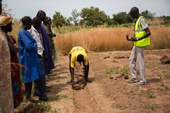 Building a new solar drier (FAOemergencies) Tags: fao food agriculture crops cultivation cultivators farmers farming fish foodsecurity sorghum aweil northernbahralgazal southsudan emergencies africa resilience groundnuts