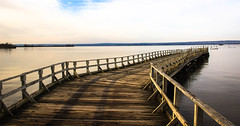perfect calm.......explored... (A. Wrench) Tags: shore shoreline chequamegonbay ashland wisconsin nature water autumn fall pier lakesuperior wood calm lake clouds landscape railing shadows reflections shoreland