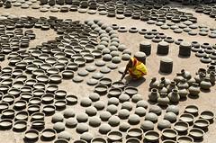 Pottery work! (ashik mahmud 1847) Tags: bangladesh d5100 nikkor working people woman light shadow