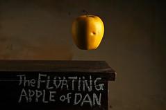 The Floating Apple of Dan (Studio d'Xavier) Tags: werehere bizarre thefloatingappleofdan apple stilllife surreal surrealism dada strobist yellow