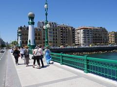 Walking over puente del Kursaal against old city, San Sebastian!