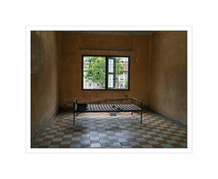 Toul Sleng - Phnom Penh, Cambodia (Maryse Tremblay) Tags: cambodia torture school prison khmerrouge war yellow room bed phnompenh marysetremblay explore